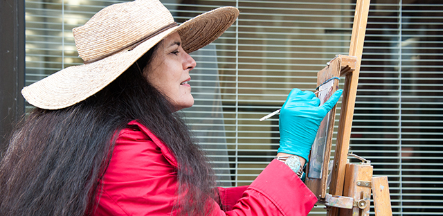 plein-air-woman-red-jacket-straw-hat-painting