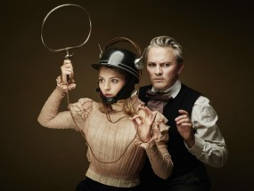 A girl with a helmet and a man standing behind her portray the characters from They Called Her Vivaldi.