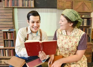 Actors portray the title characters in Tomas and the Library Lady.