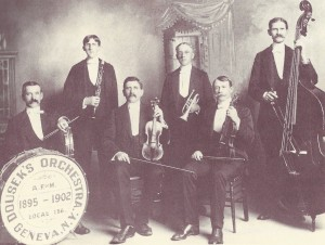 "A picture of Dousek's Orchestra that can be found in Charles McNally's history book on the Smith Opera House. The picture is captioned ""Courtesy Geneva Historical Society"" (McNally 27)."