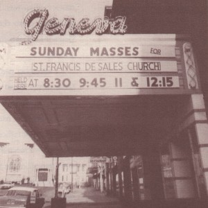 "In 1965 St. Francis De Sales Church burned down, so Gerald Fowler invited the parish to use the Smith for their Sunday services (McNally 69). They are advertised here in this picture which shows a closer look at the Geneva sign written in script on top of the marquee box. Also in 1965, Schine Enterprises lost ownership of the theatre. It is unclear in this picture whether or not the giant vertical ""Schine's Geneva"" sign has been torn down yet. Courtesy of Charles McNally's The Revels in Hand."