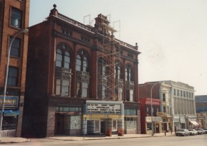 After the Finger Lakes Regional Arts Council gained ownership of the Smith in 1980, the Geneva sign spelled out in block letters on top of the marquee box was removed. This was what the marquee looked like until it was demolished in 1995. The scaffolding is a part of the facade restorations of the early 1990s. Courtesy of the Smith Opera House archives.