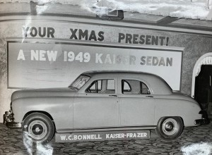 Photograph of 1949 Kaiser Automobile parked in Lobby of Smith. This photograph appears in Gerald Fowler's Scrapbook, housed in the Geneva Historical Society Archives.