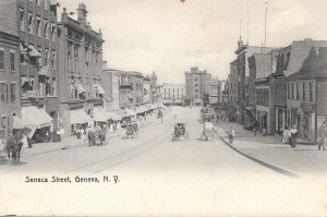 Postcard of Seneca St. with 1907 postmark, showing horse-drawn carriages and pedestrians. From the personal collection of Chris Woodworth.