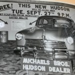 Photograph of Hudson Automobile parked in Lobby of Smith, as part of a giveaway program with other businesses. This photograph appears in Gerald Fowler's Scrapbook, housed in the Geneva Historical Society Archives.