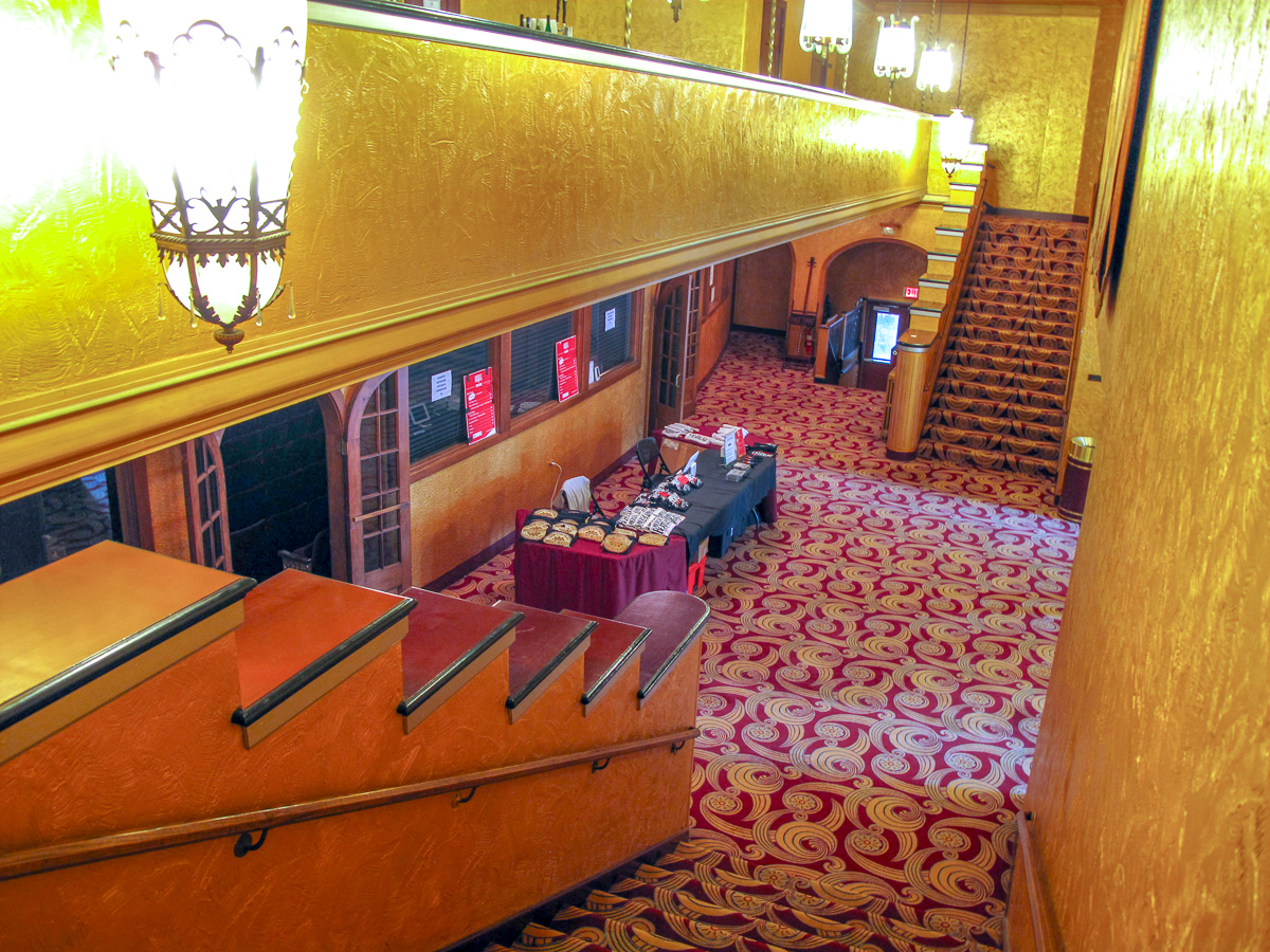The Smith lobby with gold walls and ornate carpet is prepped for an event