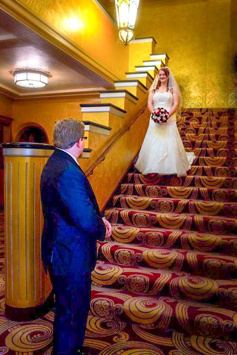 A bride walks down the lobby steps