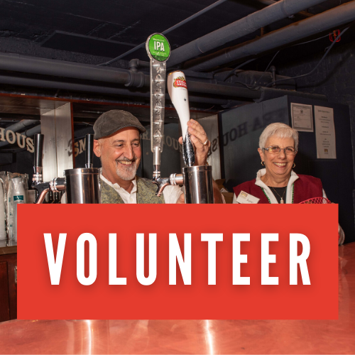 Two volunteers work our bar taps in the Smith Cabaret