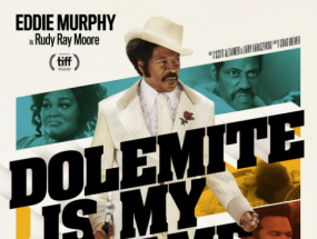 Eddie Murphy poses on the poster for Dolemite is My Name