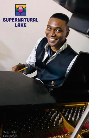 Mark Adams poses at the piano