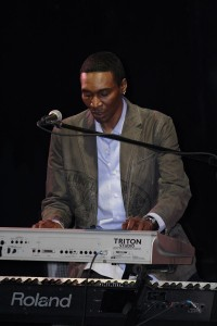 Jazz pianist Mark Adams plays the keyboard on stage
