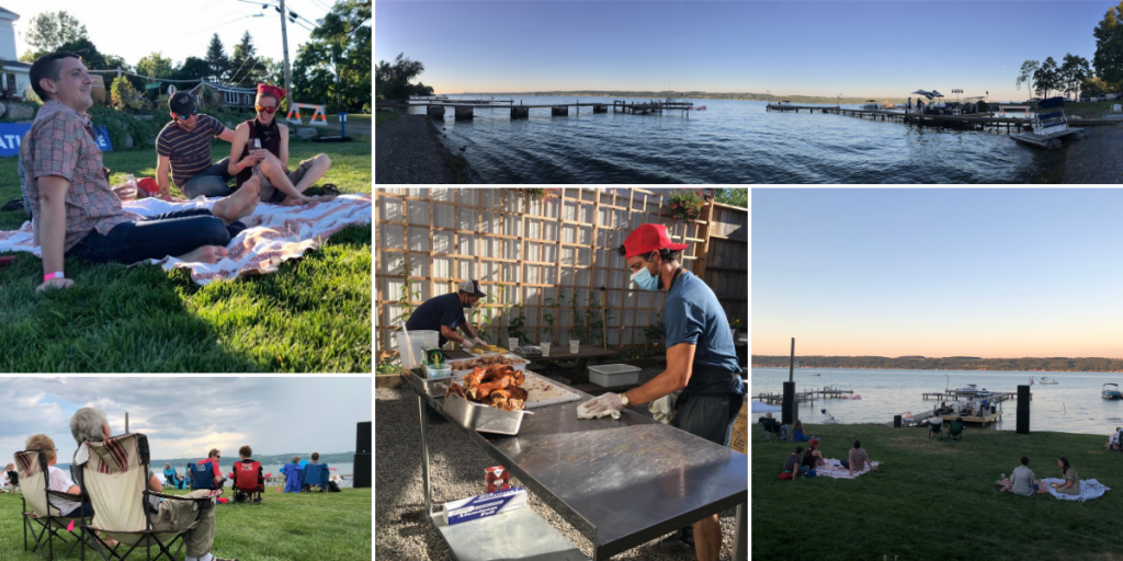 Photos from Supernatural Lake. Patrons sit on the grassed lawn facing the Cayuga lake shore line. A chef prepares the pig roast.