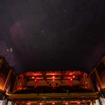 The Smith Opera House's ceiling painted to look like a cloudless night with tiny lights for stars