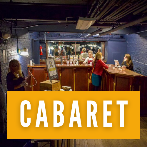 Volunteers help a patron at the Smith's cabaret