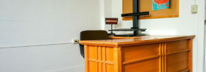 Interior shot of an office space available at the Smith featuring a wooden desk