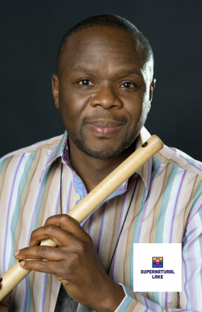Samite poses with a flute