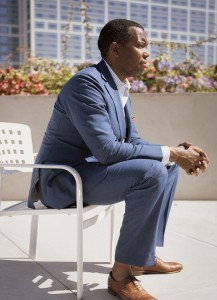 Photo of  Ta-Nehisi Coates sitting in a blue suit looking to the right