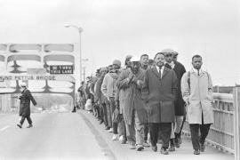 John Lewis with fellow protestors at Edmund Pettus Bridge