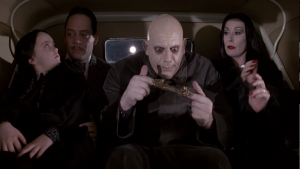Uncle Fester plays with a Chinese finger trap in The Addams Family