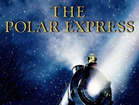 Movie poster for The Polar Express featuring a snowy suburban street at night with a large train resting as a young boy in pajamas looks up at it.