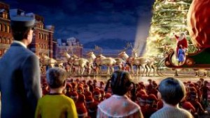 An animated photo showing three children, clad in pajamas, and a train conductor in a blue uniform, looking over a crowd and large Christmas tree.