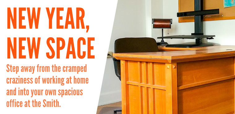 New Year, New Space: Step away from the cramped craziness of working at home and into your own spacious office at The Smith. (Photo of an wooden office desk and chair behind it)