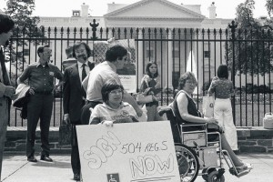 Disabled protestors occupy the sidewalk in front of the United States White House