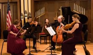 A piano quartet performs