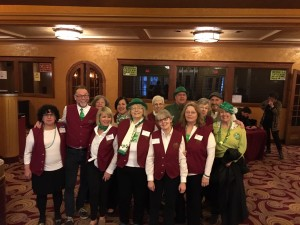 Smith volunteers dressed in St. Patrick's day colors before a performance.