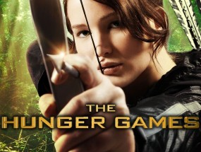 Jennifer Lawrence poses with a bow and arrow as Katniss Everdeen on The Hunger Games film poster