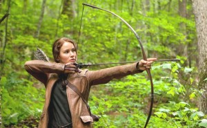 Jennifer Lawrence poses with a bow and arrow as Katniss Everdeen in The Hunger Games