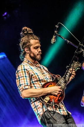 Jacob Jolliff performs on stage with his mandolin.